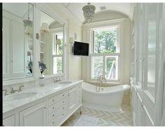 Beautiful bathroom. Chevron tile?