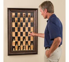 Vertical chess set, #framed for use as well as decoration.  What a great idea!