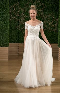 Off-the-shoulder A-line wedding dress with lace bodice and tulle skirt