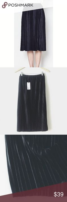 """NWT Black Velvet pleated midi skirt Brand New Boutique item! Elegant Black velvet pleated skirt. Stretchy and comfy Full-waist band.  Waist: S-12"""", M-13"""", L-14"""". Length approx 28"""".  offer welcome or bundle to save more no trade SmilingBear Skirts Midi"""