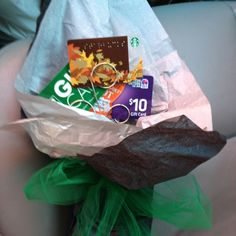 Instead of doing flowers for my son at senior night I Made him a bouquet of gift card. I used a picture holder and tissue paper to hide the base. Tied ribbon and your done.