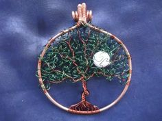 Tree of life with curly leaves & moon- if you don't want the tree, the frame and bail are worth a look ~ Wire Jewelry Tutorials