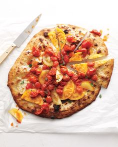 A combination of blistered cherry tomatoes and juicy fresh heirlooms adds color and flavor to this white pizza.