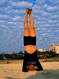 Photo: Man performs yoga on a beach in Okinawa, Japan
