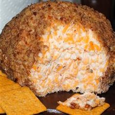 Buttermilk Ranch Cheeseball: Sour cream, ranch dressing mix, cream cheese, cheddar cheese. Rolled in bacon bits--Delicious :) the recipe says to roll the cheese ball in walnuts but we rolled it in REAL bacon bits from the store (not the fake ones in a shaker), and it was delicious!!