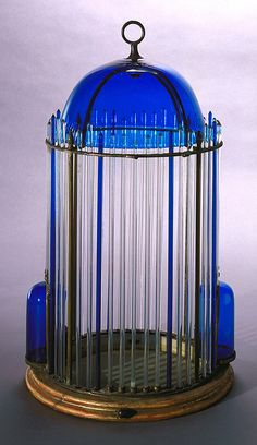 Birdcage (Italy), 19th century    Glass, silver-plated metal, metal, gilt wood. Gift of Eleanor and Sarah Hewitt. 1916-19-92-a/g