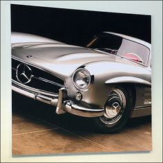 A racy angle on this Mercedes Benz Classic Silver Roadster Poster makes it impossible to tell if this is a hardtop, convertible or gullwing model. Mercedes Benz Retail, Retail Fixtures, Poster Making, Antique Stores, Convertible, Challenges, Antiques, Classic, Car