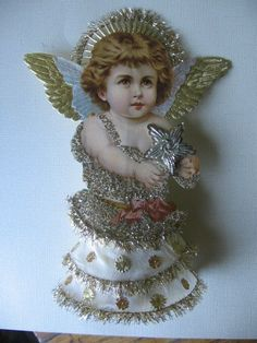Vintage Look Victorian Christmas Ornament -German Scrap Angel Topper/ This is the angel we had on top of our tree when I was growing up, in the and Victorian Christmas Decorations, Victorian Christmas Ornaments, Antique Christmas, Christmas Past, Christmas Tree Toppers, Xmas Ornaments, Christmas Angels, Christmas Themes, Handmade Christmas