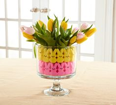 Brighten up your table with this easy to create Trifle Bowl centerpiece. Just fill with your favorite candy, and top with springtime flowers (we like tulips and daffodils).