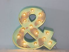 These OLD vintage inspired lighted Symbols, Numbers & Letters are made of heavy duty raw metal and stand about 12 tall. Each letter or symbol is