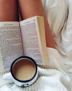 coffee and a good book. a cozy day in bed with good vibes.