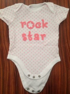 "Felt application "" rock star"" on baby clothes"