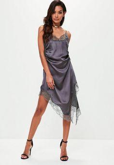 Grey slip dress featuring an asymmetric lace hem, seam split, v neckline and adjustable cami straps.