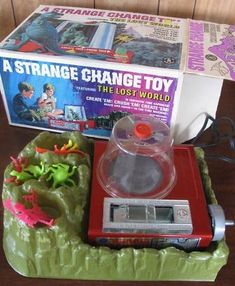 """better photo of Strange Change Time Machine toy ...my favorite.  I won two of these on Ebay and since re-sold them. So many of us loved this kids, but be warned: I bought this anxiously wanting to share the fun with my son without thinking of the generation difference. This is way too slow paced--boring--for todays youth. All I heard was """"that's it??"""" and """"it takes too long"""". *sigh*"""