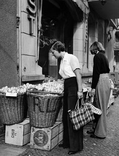 German Empire Everyday Life women in front of a fruit shop Photographer Peter Weller Published by 'Das Blatt der Hausfrau' 19/1939Vintage property of...