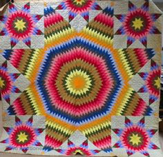 Multi colored antique star quilt, seen at auction