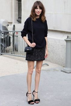 black sweater, skirt, and heels