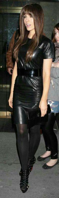 Belted black leather dress and black hose