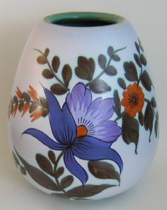 Flora Gouda Pottery vase decorated with the Iris pattern. Marked Flora Gouda, Holland.