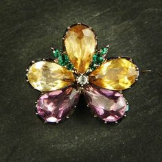 Georgian pansy brooch c1820. Set with amethyst & topaz paste petals, and tiny emerald & diamond paste highlights.