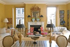 like the blue and white tulipieres on mantel with black lampshades and gold mirror