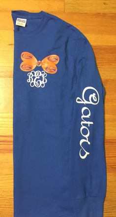 Monogrammed Florida Gator is the perfect gift! This shirt features your monogram on the front with Gator Bow and Chevron Anchor on back and Gators down the sleeve. Shirt Shown is long sleeve royal blue with orange and White HTV vinyl (glitter and non glitter). If you would like another color shirt instead, please leave comment in notes. Otherwise shirt will done as shown, In the notes, include the monogram color and the monogram in the following order: first, LAST, middle ***All shirts ar...