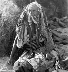 Old bedouin woman from southern Palestine at the grinding stone, ca. 1930