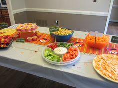 The party at each station or on the food items elmo themed party
