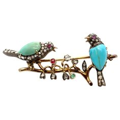 A very lovely Victorian brooch depicting a nest with two birds and flowers. The birds are studded with ruby eyes, diamond and turqouise and the flowers are studded with diamonds and a ruby and an emerald. - with French gold stamp mark Victorian Gold, Victorian Jewelry, Antique Jewelry, Vintage Jewelry, Vintage Pins, Cameo Jewelry, Bird Jewelry, Animal Jewelry, Jewlery