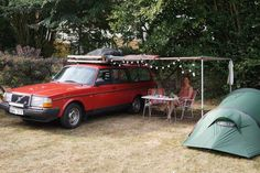 Camping in style in this beautiful Volvo 240 wagon. Why can't this be my life?? Also, the red 240s are really growing on me... #volvo240