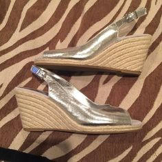 Silver Metallic Wedges Worn once on vacation, very cute-- pictures do not do them justice! Only evidence they've been worn is the inside or insole and it's very minor. They look amazing on! BCBGeneration Shoes Wedges