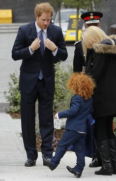 The Prince met a young boy with a bright red locks during the Met Police's annual service of remembrance today
