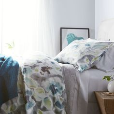 Soft sheets and comforters in cool blues and greys – dive on in.
