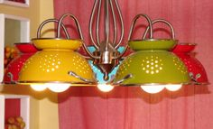 Fun kitchen light using colorful colanders in fiestaware colors.