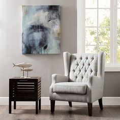 This classic wing chair with its button tufted detailing and sloped arms adds a casual twist with its linen casual woven fabric.