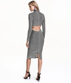 Silver-colored/glittery. Fitted, knee-length dress in stretch jersey with glittery threads. Mock turtleneck, long sleeves, and open section at back with a