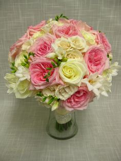 Large handtied wedding bouquet of O'Hara garden roses, polar star roses, white majolika spray roses and white freesia. It is 14 in. diameter and gorgeous!