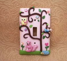 Ahh! And I'll def be buying this one too!! Sooo cute :-) Mia - Yellow Owl, Blue Hedgehog, and Pink squirrel - Children's lightswitch cover - Nursery. $21.00, via Etsy.