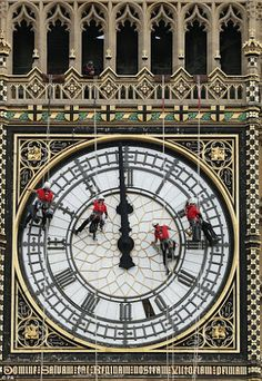 A team of cleaners on the face of Big Ben the famous clock in London, England. Photo: google+.com/search/London