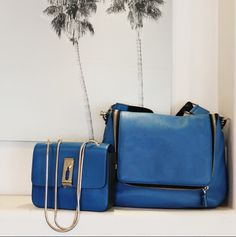 @anyahindmarch has got the blues... and they're gorgeous. Get your hands on the Albion Small Shoulder Bag ($1,295.00) and the bestselling Maxi Zip Satchel ($1,350.00) by calling 1.877.342.6474.