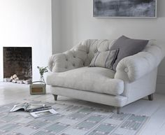 This deep buttoned beauty, the Bagsie love seat, is a seriously cool take on a classic Chesterfield. This sumptuous love seat is handmade in Blighty.