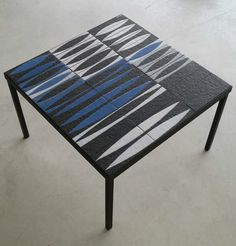 Roger Capron; Glazed Ceramic Tile and Enameled Metal 'Navettes' Low Table, 1950s.