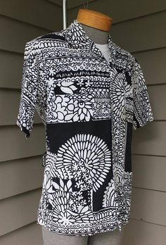 Sandwich Isles - Honolulu Cotton Large, not labeled (please rely on measurements & description) 1970s  Short sleeve cabana or pool shirt. Bold Black & White stylized floral print on cotton sail cloth with Black contrast stitching. Four pocket front which originally had a waist belt. Belt