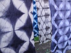 Itajime shibori scarfs dyed with indigo or procion color, all made by me at my studio in Copenhagen!