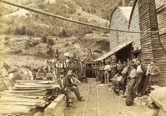 4 Tunnel, Mt Lyell, Tasmania, Australia showing miners and narrow gauge tracks leading into the mine. Van Diemen's Land, Aboriginal History, Australian Continent, Gold Prospecting, Romantic Images, Largest Countries, Small Island, Tasmania, Dog Photos