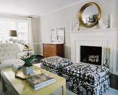 Love the ottomans in front of the fireplace