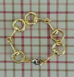 Check out this item in my Etsy shop https://www.etsy.com/listing/220092274/gold-snaffle-horse-bit