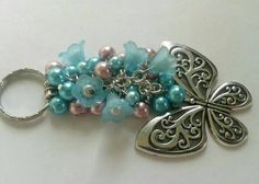 Beautiful beaded butterfly bag charm key chain by Thejewelden