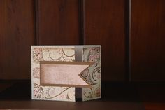 The decorative stamp work ads a beautiful touch to a simple tri fold card.