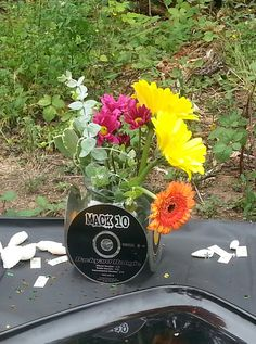 Attached old CD's to small vases that I had around the house for a 90's hip hop themed bbq in the park.